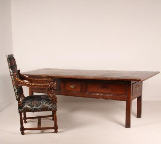 "Constructed from solid chestnut, this table is 19th Century, has a beautiful warm color and patina and is very large. Over 98"" Long x 45"" Wide x 30"" High. Has four drawers."