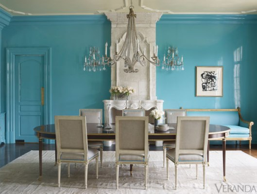 In this photo a Louis XVI table and Louis XVI chairs are paired for an elegant dining room designed for entertaining.