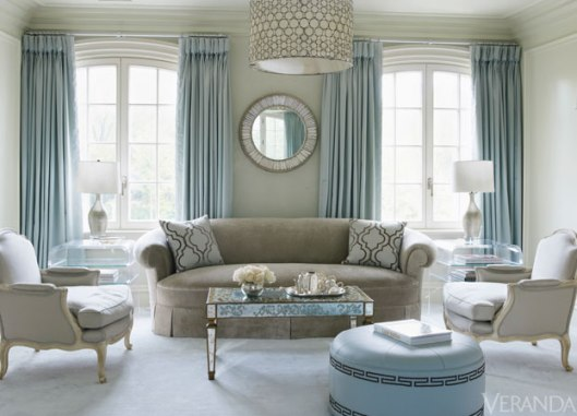 Note the sumptuous Louis XV Bergeres paired with a deco styled coffee table. I love the color palette in this room!