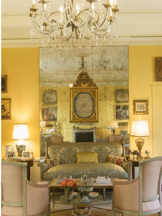 I find the use of this brilliant yellow a little dated as well as the use of the faux finished mirrors.
