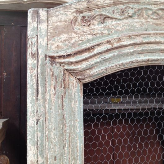 This is a lovely finish that looks like a 200 year old piece. Three layers of paint worn down to a sandblasted wood frame.