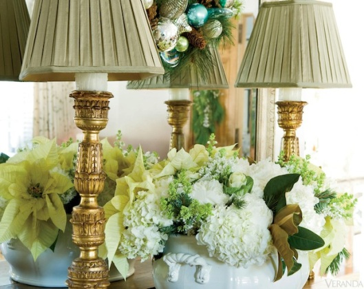 White poinsettias, hydrangea, and kale are used in this imaginative and luxurious display