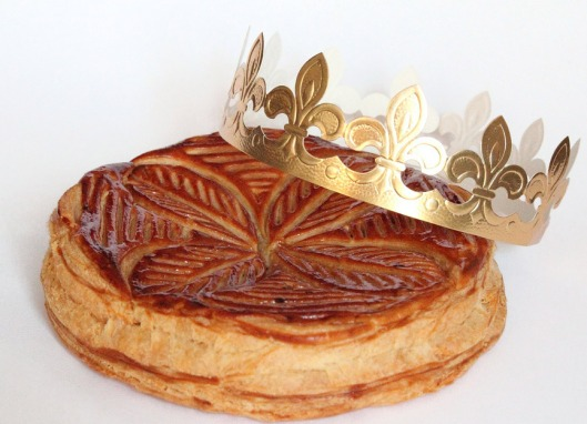 These delicious cakes appear everywhere throughout France and usually include the paper crown shown in the photo. they are layers of pastry with a center of almond paste or marzipan. I've had two presented to me after a dinner where the hostess did not want to keep it for the fact that it is seriously high in calories.