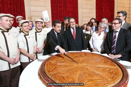 Former French President Sarkozy cutting into a Galette du President!